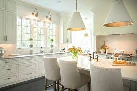 pendant lights over dining table timeless kitchen with dining table in white cabinet and white chairs white cabinet floating cabinet pendant lamp height