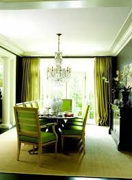 green dining room furniture. Fresh Green Paint In Modern Dining Room With Chandelier Chairs Dark Oval Tabe And Brown Rug Image Furniture