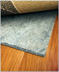 rug pad for hardwood floor rugs floors best area wood home decorating in kitchen placing on