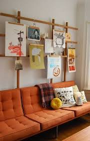 ideas for hanging artwork without leaving holes in the wall