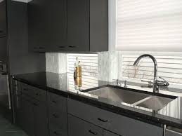 black granite countertops with maple cabinets