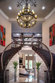 a magnificent classic spanish colonial double staircase entryway is polished by stenciled faux
