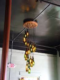 Looking for a great DIY home decor project? We've got a bright idea for  you! Why not make a DIY wine or beer bottle chandelier. Most of us save our  wine or ...