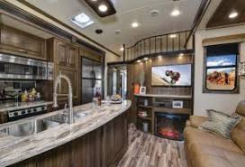 evergreen rv s tesla t3950 toy hauler is everything an rv enthusiast is looking for at 43 and a half feet long and 102 inches wide the tesla t3950 is