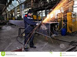 Metal Worker Grinds Weld Steel Sections Using An Angle Grinder Metal Worker
