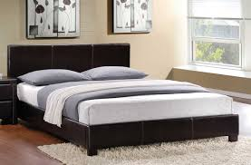 make a statement in your bedroom with this dramatic platform bed covered in dark brown faux leather full size 199 queen size 199 king size 299