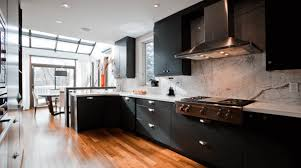 black kitchen cabinets with white marble countertops. Contemporary Kitchen With Dark Wood Cabinets And White Marble Black Countertops