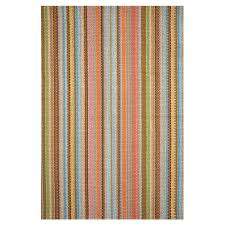 a woven rug in colorful stripes is the perfect choice for anchoring a kitchen or mudroom