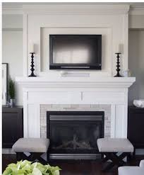 this is the exact lay out of my formel living room with windows built in shelves on each side i would never paint my brick or masonry but i love the tv