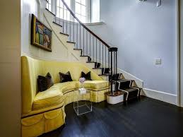 yellow sofa on curved staircase wall view full size