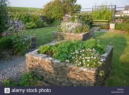 raised flower beds with stone borders ireland stock image