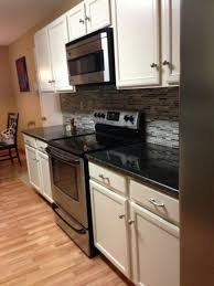 white cabinets with dark countertops kitchen backsplash ideas black granite countertops white cabinets sloped ceiling entry craftsman expansive paint home