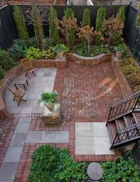 Outdoors:Tiny Backyard Design With Beautiful Brick Patio And Small Wood  Chairs Also Small Stair