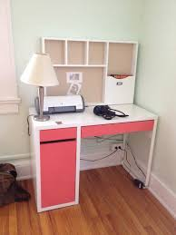 cute ikea micke desk in white and pink with hutch and storage on wooden floor for