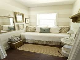 Dazzling Tabl Lamp Added Into The Brown Guestroom With Striped Small Guest Room Ideas