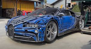 Bugatti only electronically limits its top speed at 440 km/h. Check Out This Bugatti Chiron Replica Made From Scrap Metal In Thailand Carscoops
