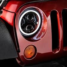 7 round black projector led headlights with switchback halo installed on a jeep wrangler