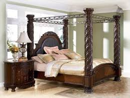 Amazon.com: Ashley North Shore King Canopy Bed in Dark Wood: Kitchen ...
