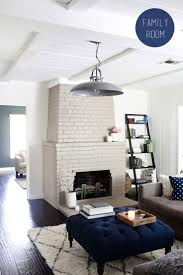 The Blue Table thing ! // Gray and navy living room with painted brick  fireplace, by The Effortless Chic, photography by Kimberly Genevieve