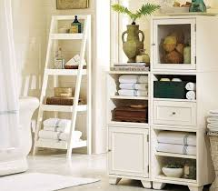 outstanding vintage bathroom decor ideas with ladder shelves for storage also white wooden cabinet plus ceramic wall and vase jar