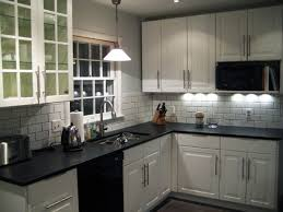 White IKEA kitchen with dark-grouted tile. My mom wants a white kitchen (