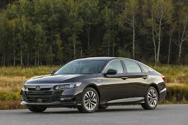 this photo provided by honda shows the 2018 honda accord hybrid the vehicle offers new changes for 2018 such as improved trunk e and a folding rear
