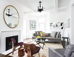 beautiful wall mirrors above fireplace for ultra modern living room interiors with elegant white paint colors ideas