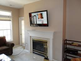 flat tv above the white fireplace placed on the cream wall terrific ideas for wall