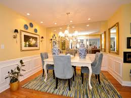 pale yellow dining room. blue yellow dining room pale with mirrored wall and chairs hgtv