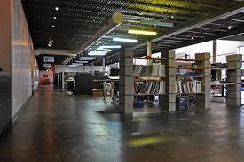loft style office. cinder block shelves as room dividers loft style office