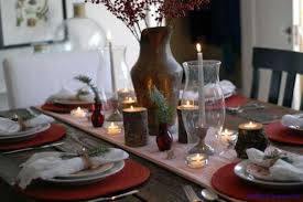 Great Table Decor With Handmade Candle Holders And Red Placemats For Winter  Decorating