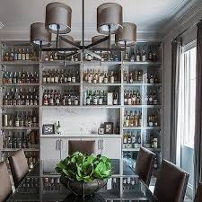 gray dining room with full wall of built in gl front bar cabinets