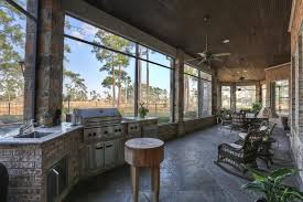 screened patio with outdoor kitchen