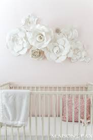 paper flowers as wall decor in a nursery what a gorgeous soft feminine on flower wall art for nursery with paper flower wall art in the nursery maison de pax