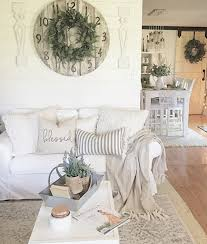 love the look of these layered farmhouse rugs in a family room layer a patterned