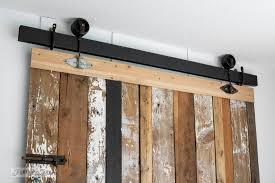 A cheater reclaimed wood barn door headboard with faux hardware. Get the  look without the