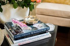 when on a console table i like to use an easel to showcase my favorite book as with the white one below the height difference between the stacked and
