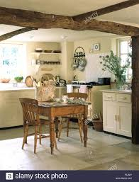 cottage kitchen furniture. Vintage Pine Dining Table And Chairs In A Cream Cottage Kitchen With Range Oven Rustic Wooden Ceiling Beams Furniture T