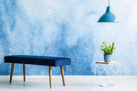 blue velvet bench. Navy Blue Velvet Bench Next To Table With Plant Under Lamp In Anteroom Interior Stock Photo