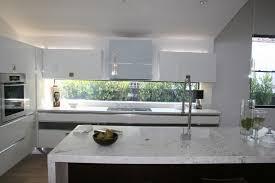 calacatta marble kitchen waterfall: modern kitchen by see construction modern kitchen modern kitchen by see construction