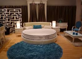 Smple Round Bed Design With Blue Pillow And Furry Area Rug And Wooden Floor  And Turquoise