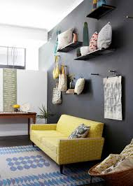 yello and grey sofa with black wall