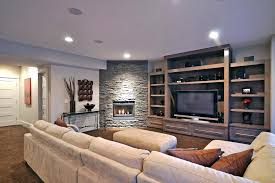 stone corner fireplace living room contemporary with none image by electric tv above