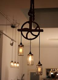 industrial lighting ideas. corner of design studio love this repurposing idea an old pulley and mason jars turned into a light fixture industrial lighting ideas