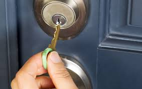 person locking door. Person Preparing Home For Vacation By Locking Door L