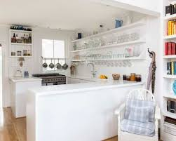 coastal kitchen ideas. Design Ideas For A Small Nautical U-shaped Kitchen In Kent With Open Cabinets, Coastal
