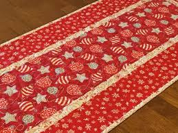red and silver table runner quilted table