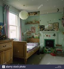 Paper Lantern Bedroom Pine Bed In Childs Pastel Green Bedroom With Fireplace And Paper