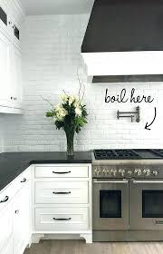 Backsplash With White Cabinets Black And Painted Brick Against Honed Granite Tile Grey Subway
