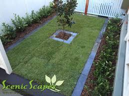 empire zoysia lawn with 600x600 sandstone paving on concrete flush face link block retaining walls lysaght good neighbour fencing 90x19 kwila slat fence